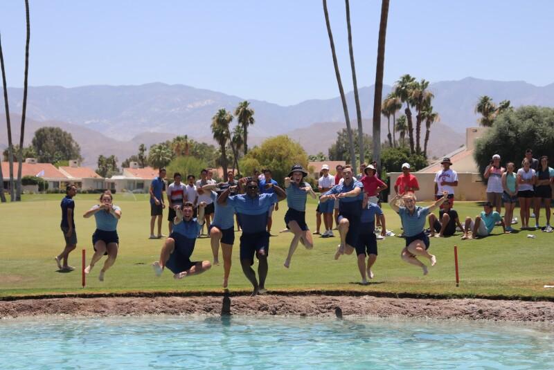 Mitch Garlitz and Summer Intern Team Jumping into Poppie's Pond.JPG