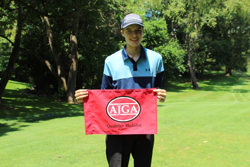 Emil Reigger with qualifier madalist flag -2021 Junior at Knollwood presented by Yoder Oil.JPG
