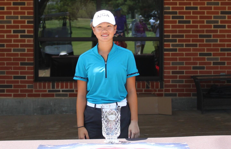 Mackenzie Lee trophy with table.JPG