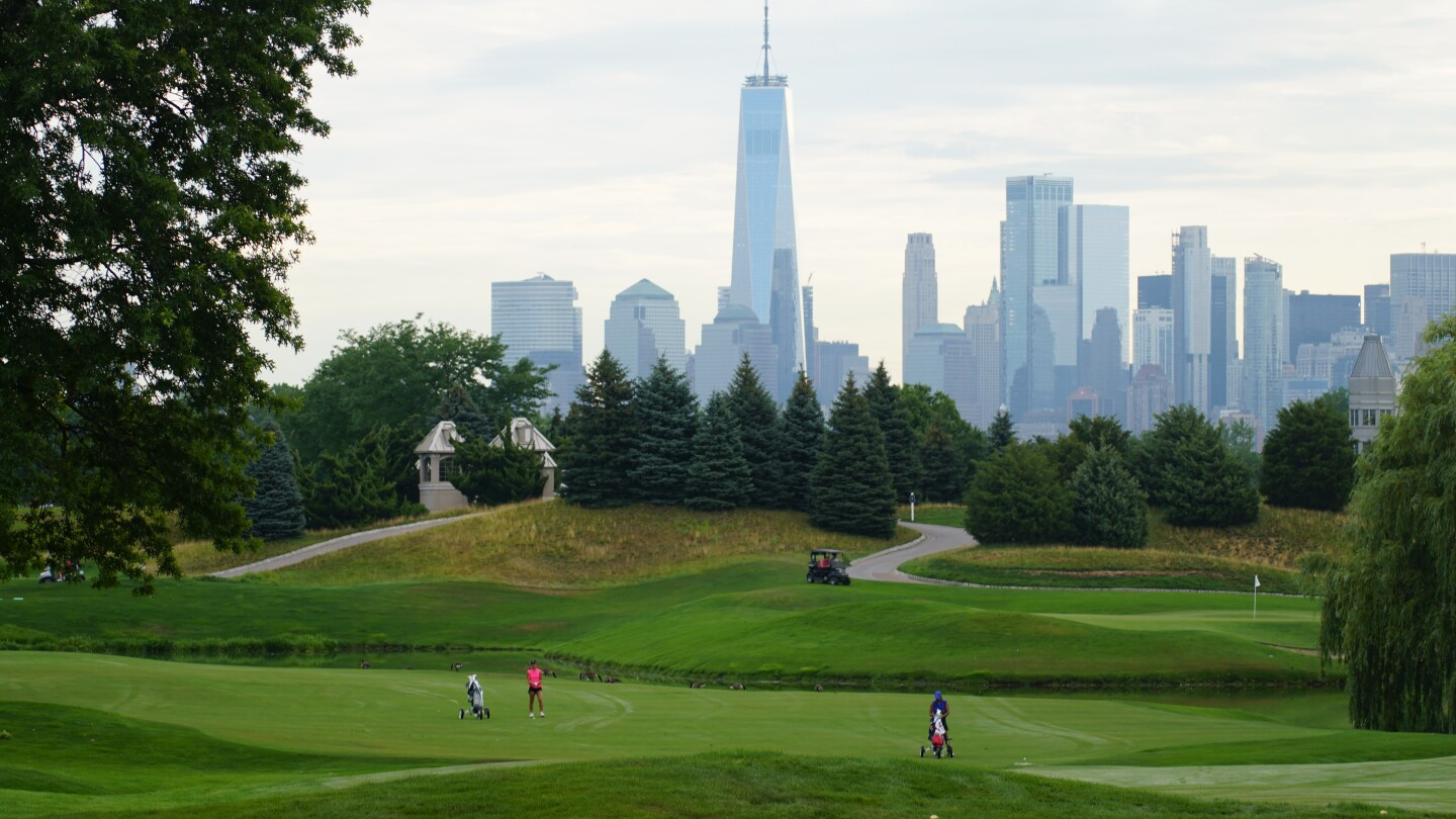 Katie Li and Megha Ganne in Fairway with NYC in the background - 2021 - Polo Golf Junior Classic.JPG