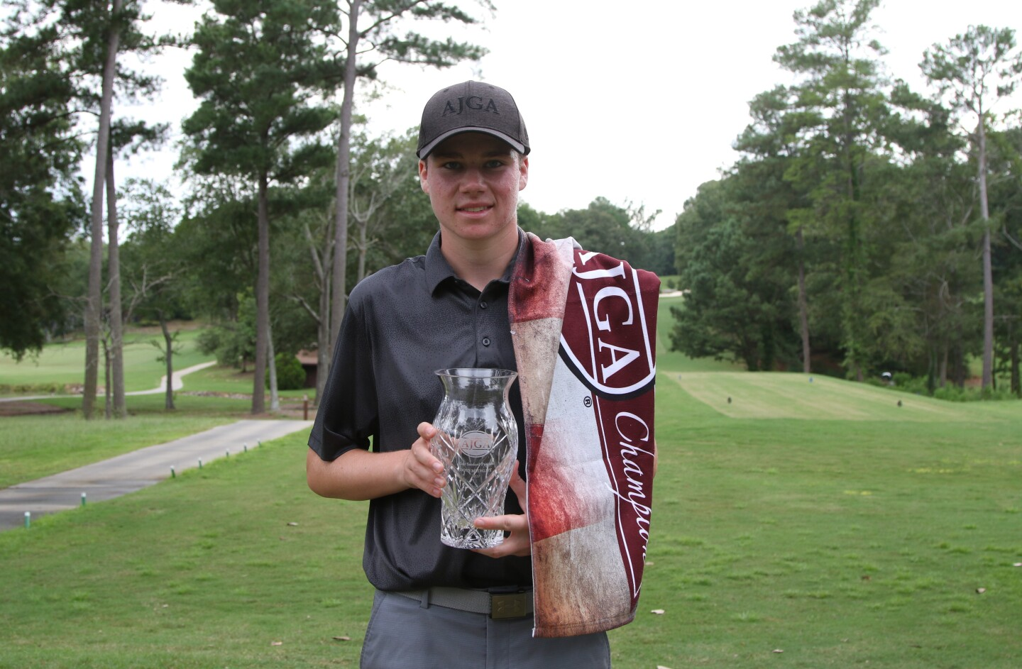Keenan Royalty First Place Medalist with champion towel - 2020 - Visit Sanford Preview.jpg