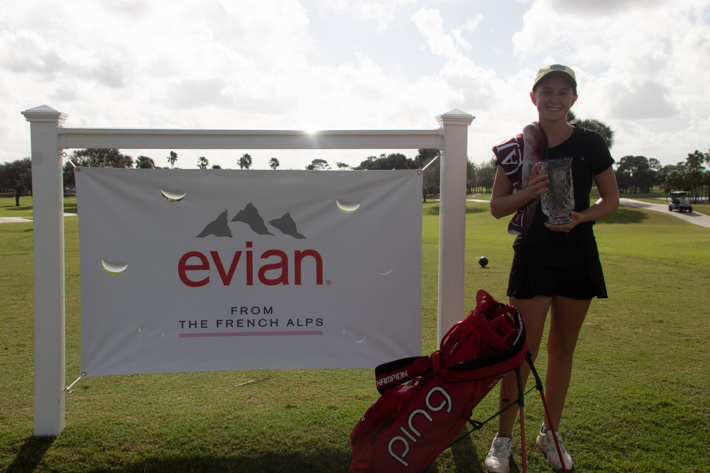 Caroline Patterson Champion photo with ping bag with evian sign - 2020 - evian International and Senior Showcase.jpg