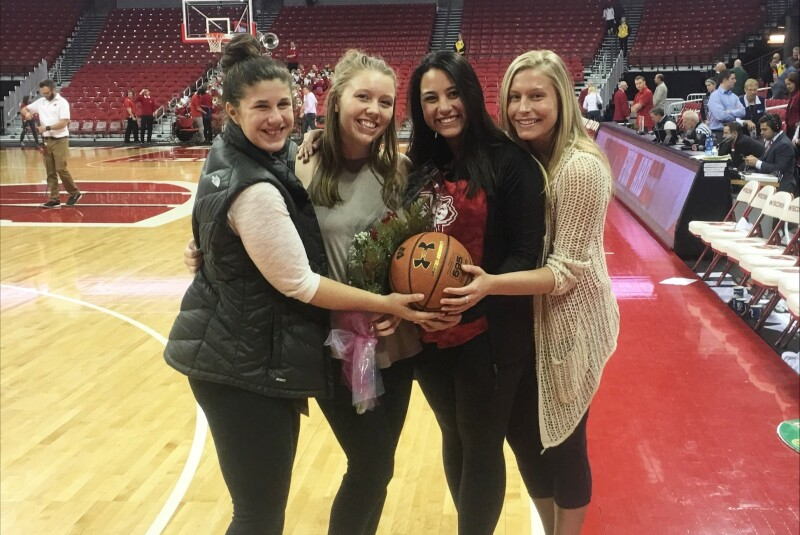 Katie Nord with Basketball Roommates on Senior Night.png