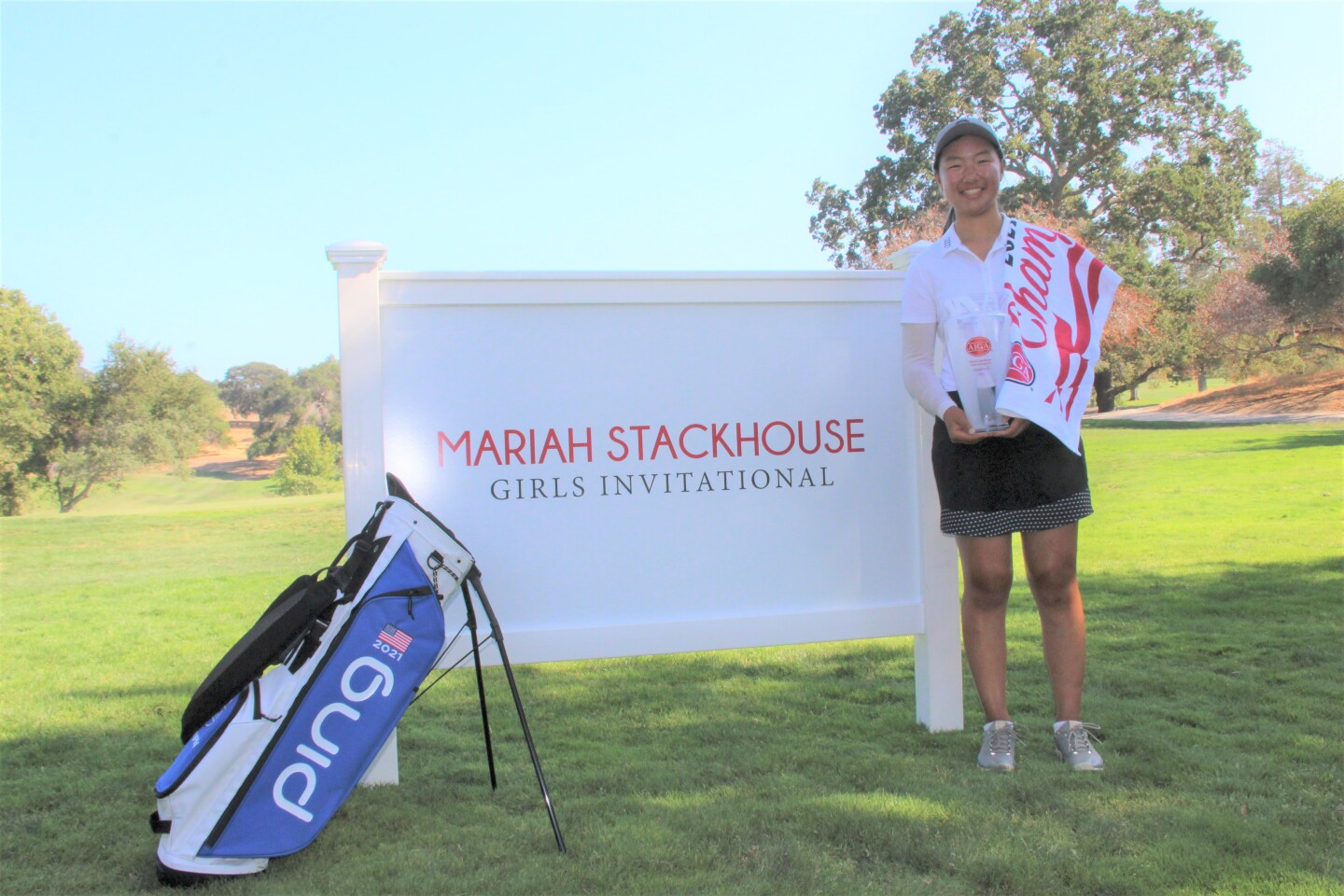 Michelle Liu Champ Bag trophy in front of signage - Mariah Stackhouse Girls Invitational - 2021