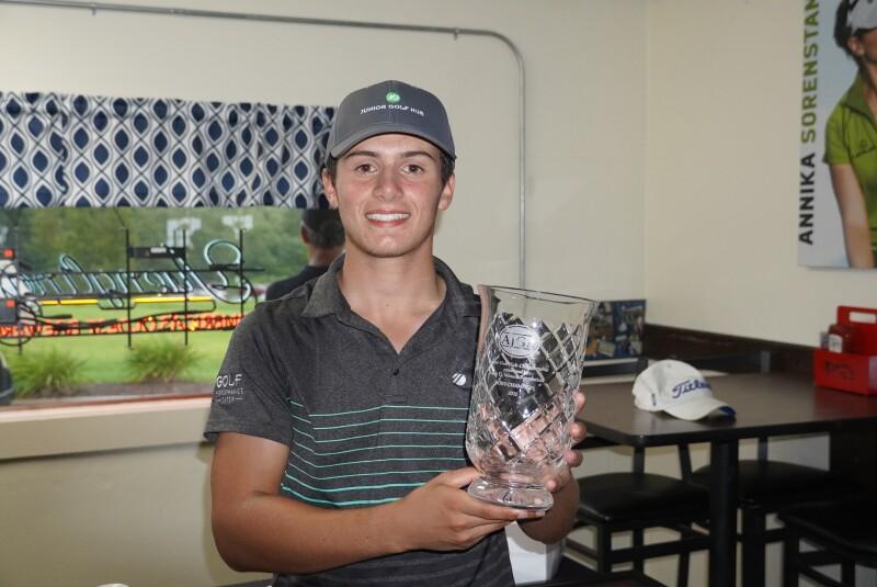 Elias Kennon with trophy -2021- Junior Golf Hub Championship presented by John D. Mineck foundation.JPG