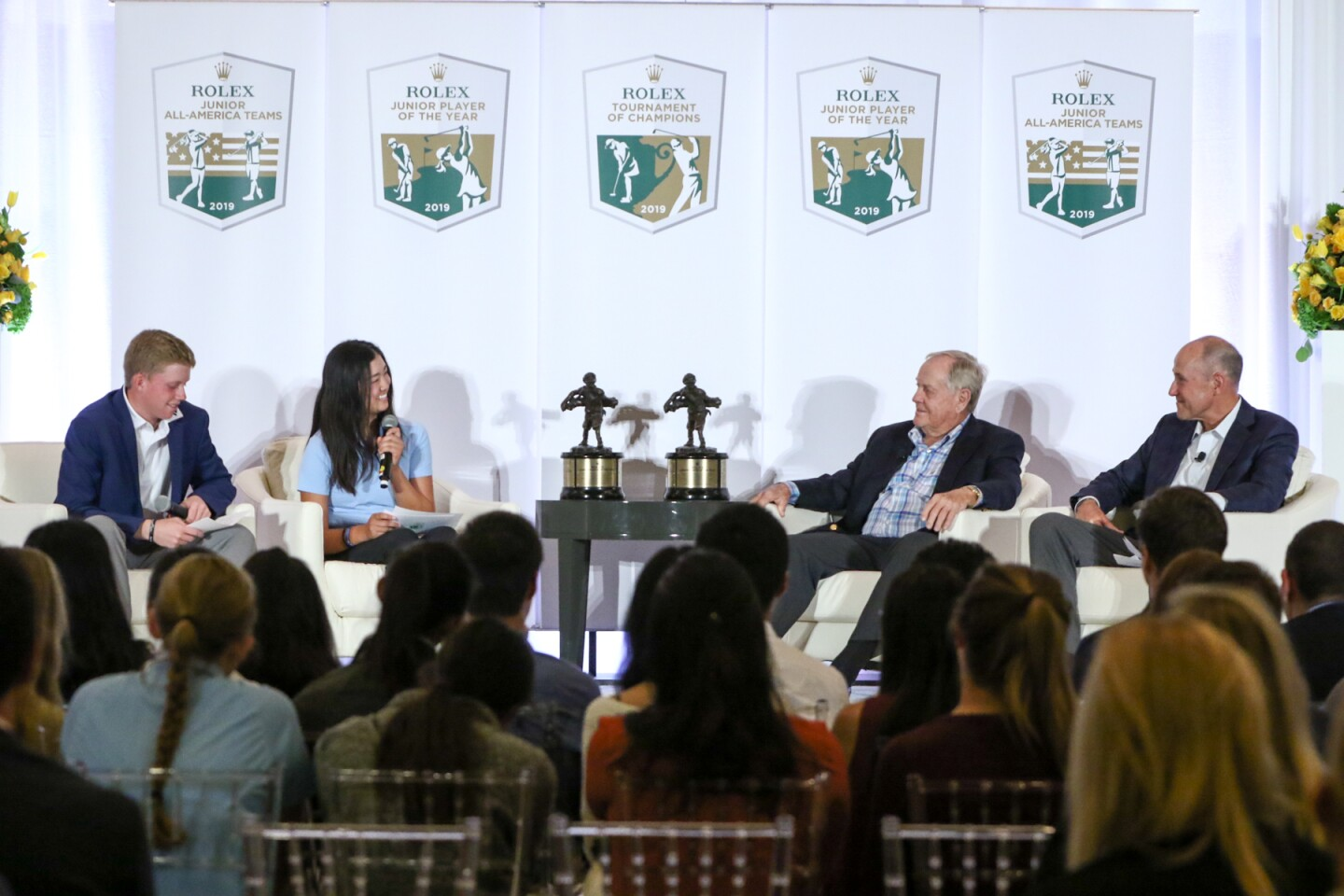 Maxwell Moldovan, Rose Zhang on stage with Jack Nicklaus and Stephen Hamblin at Rolex Tournament of Champions.jpg