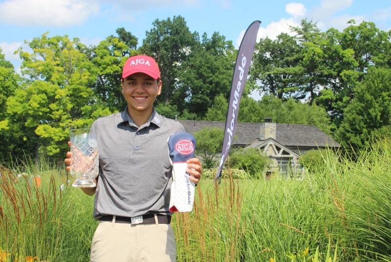Luke Sample champion with TaylorMade lowround trophy and AJGA hat.JPG