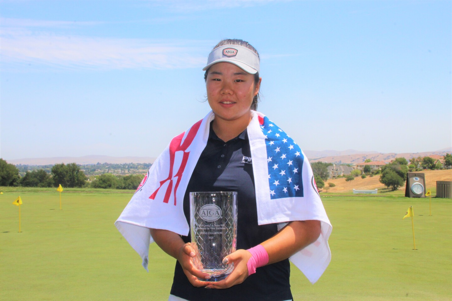 Ashley Yun with champ towel and trophy-2021-AJGA Junior at Ruby Hill presented by Visit Tri-Valley.JPG
