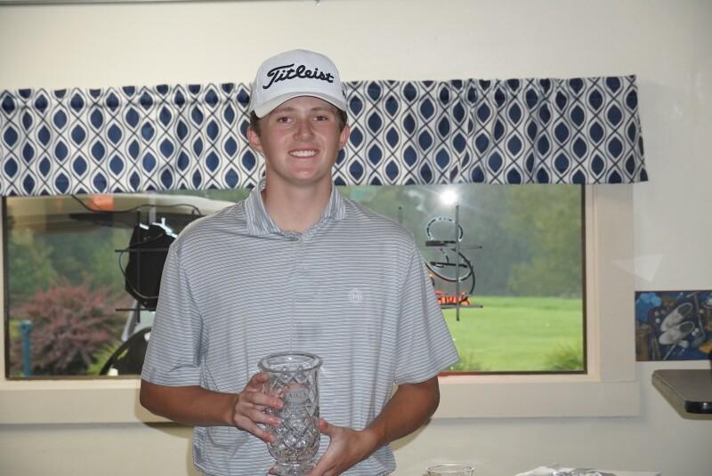 Logan Paczewski with second place trophy -2021- Junior Golf Hub Championship presented by John D. Mineck foundation (1).JPG