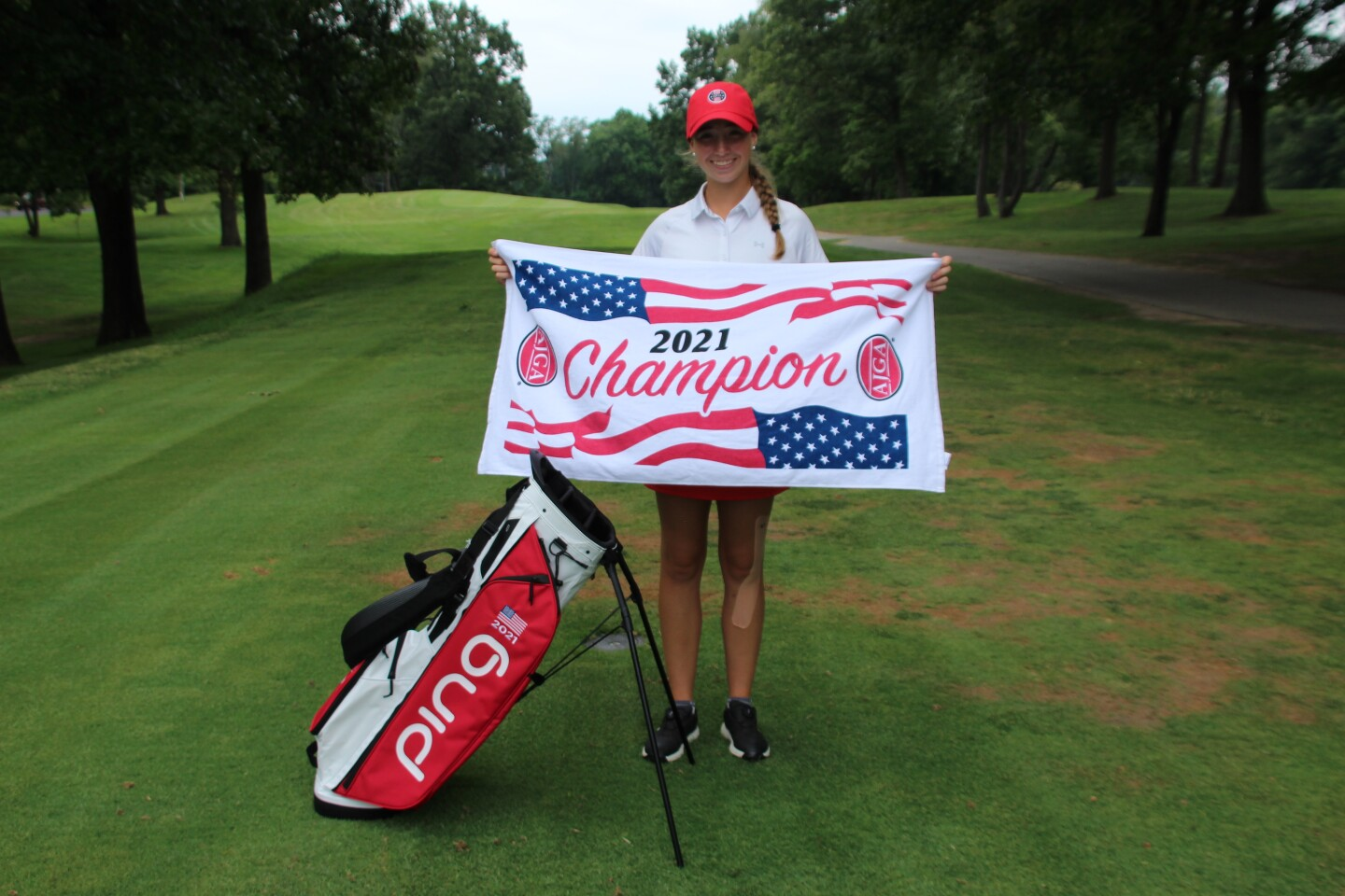 Kary Hollenbaugh with champ towel and bag  -2021 AJGA Junior at Knollwood presented by Yoder Oil.JPG