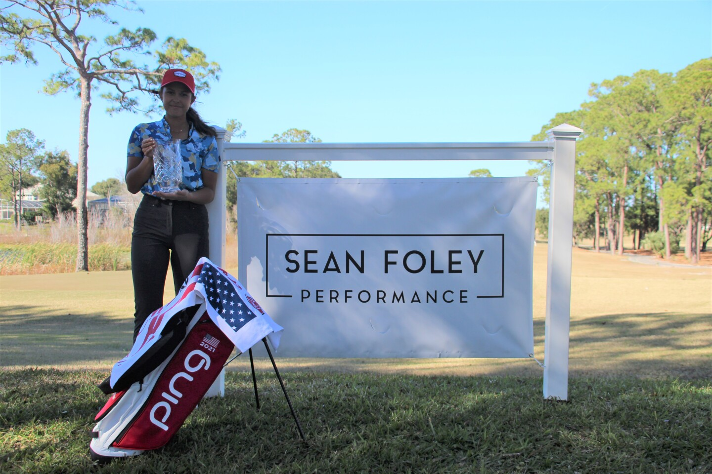 Yana Wilson Champ banner with banner  - Sean Foley Performance Junior Championship - 2021.JPG