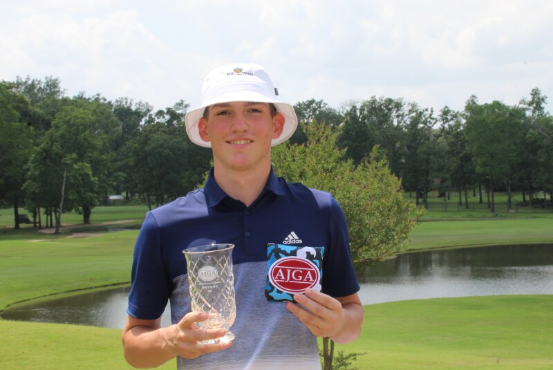 Logan Zurn with 2nd place trophy and TaylorMade putter cover-2021-AJGA Shreveport Junior.JPG