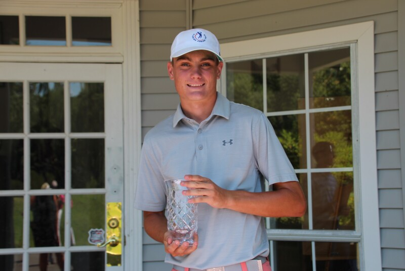 Colton Swartz with second place trophy infront of building-2021-St.Francisville Area Foundation Junior at The Bluffs.JPG
